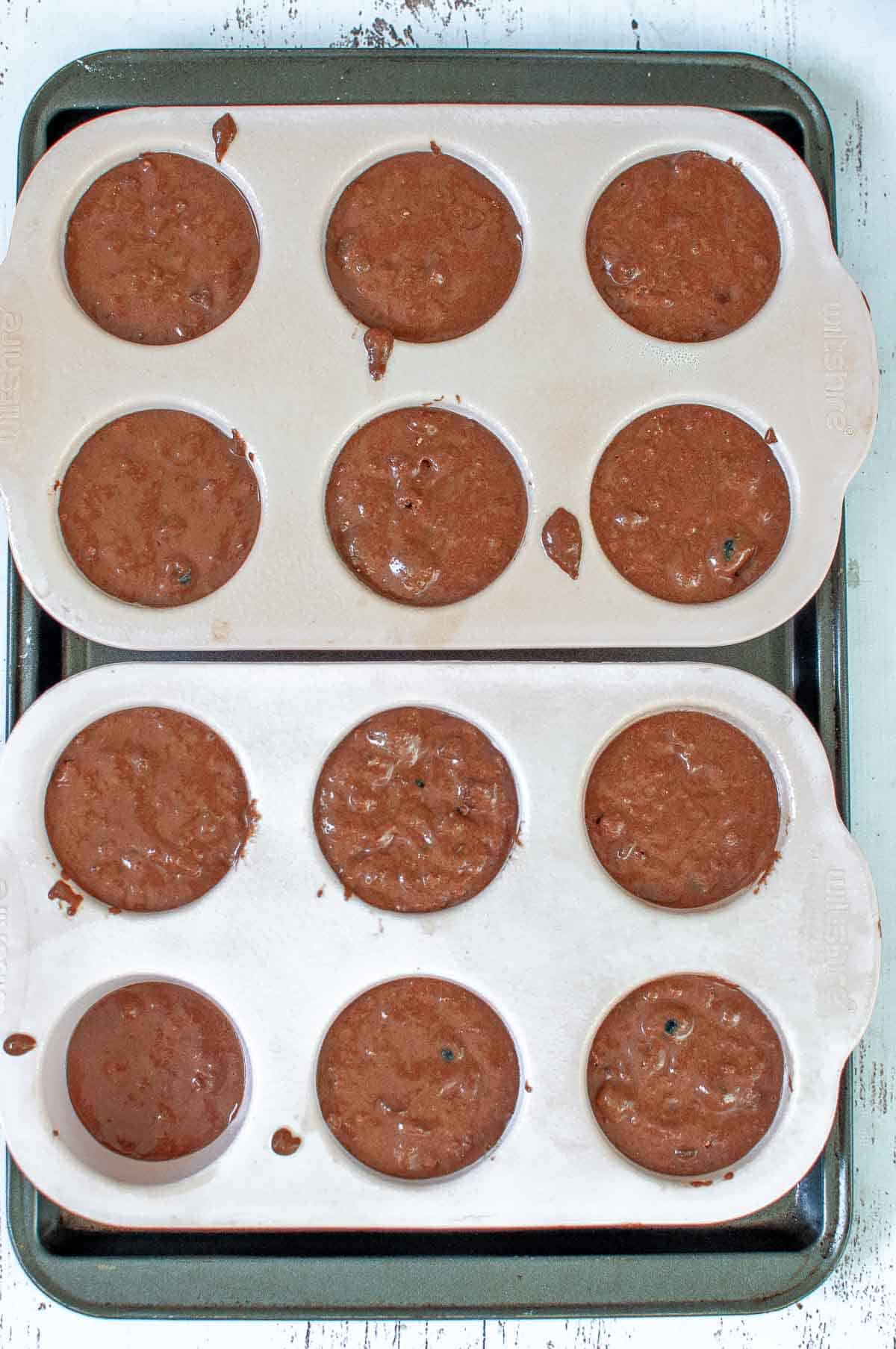 muffins in silicone moulds ready for baking