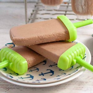 3 Chocolate Banana Popsicles on a plate