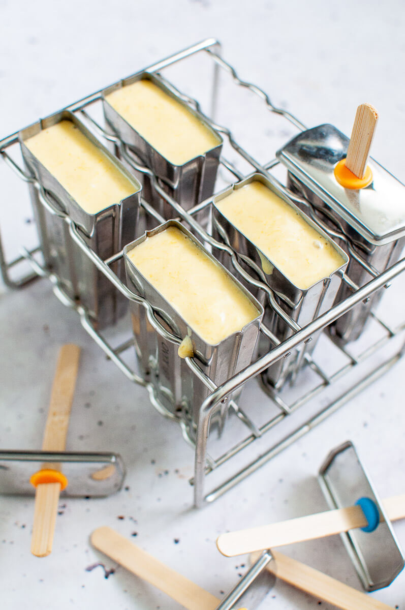 mango popsicles in popsicle molds