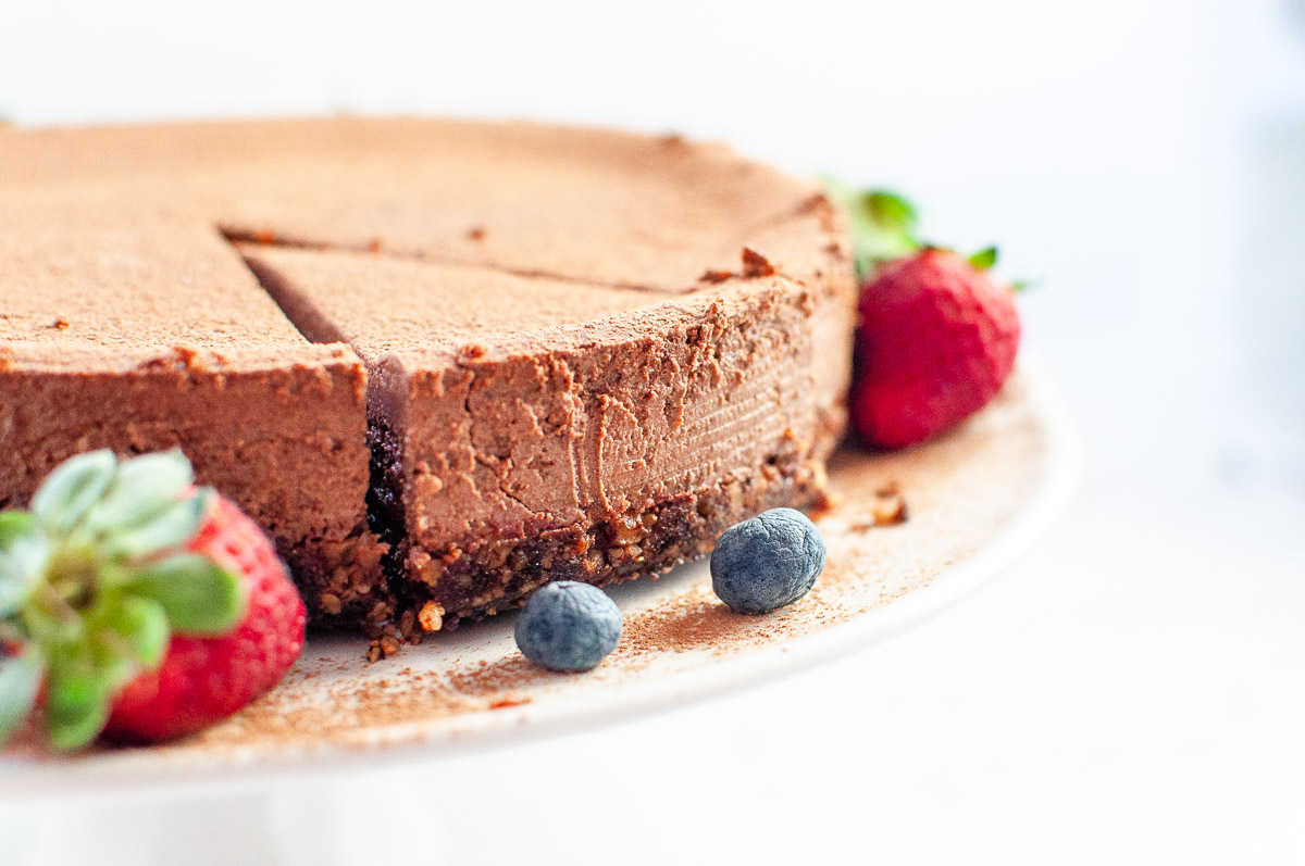 chocolate ricotta cheesecake on a platter ready for serving