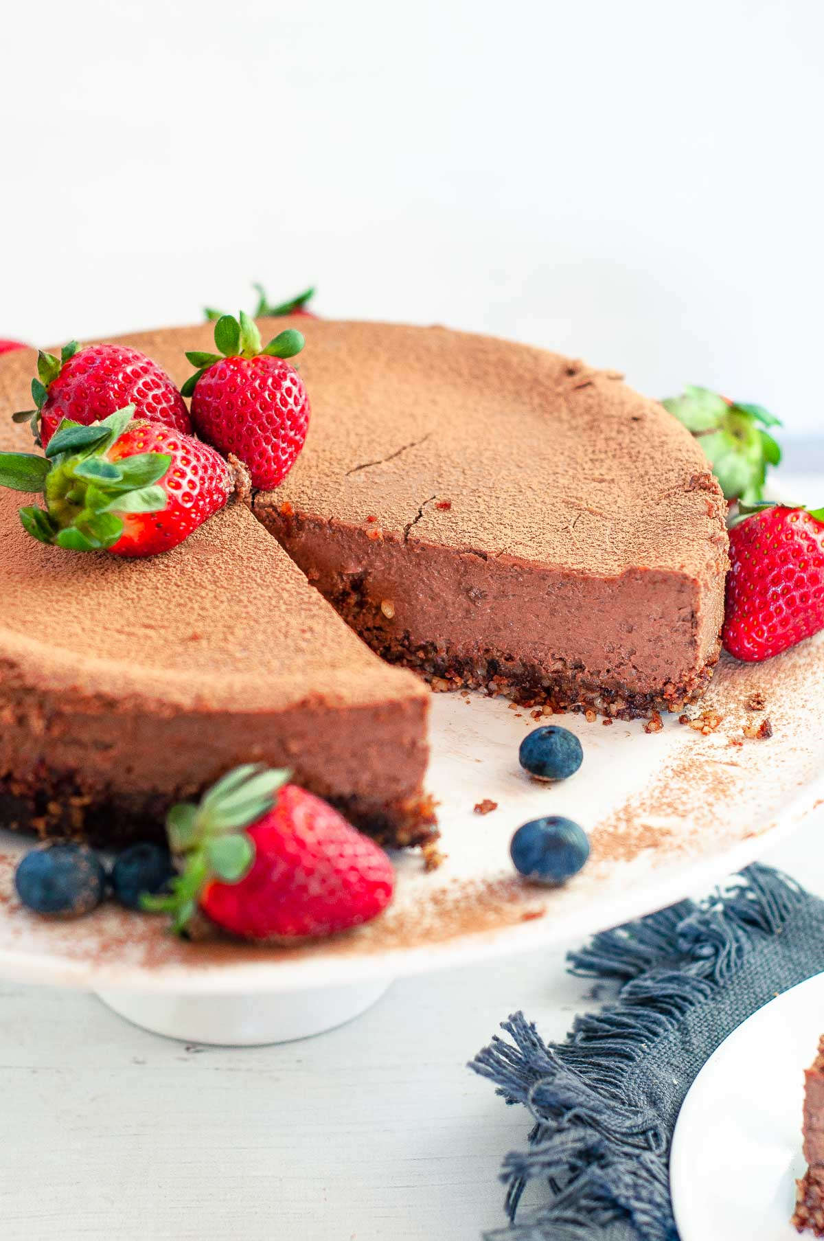 chocolate ricotta cheesecake on a serving platter