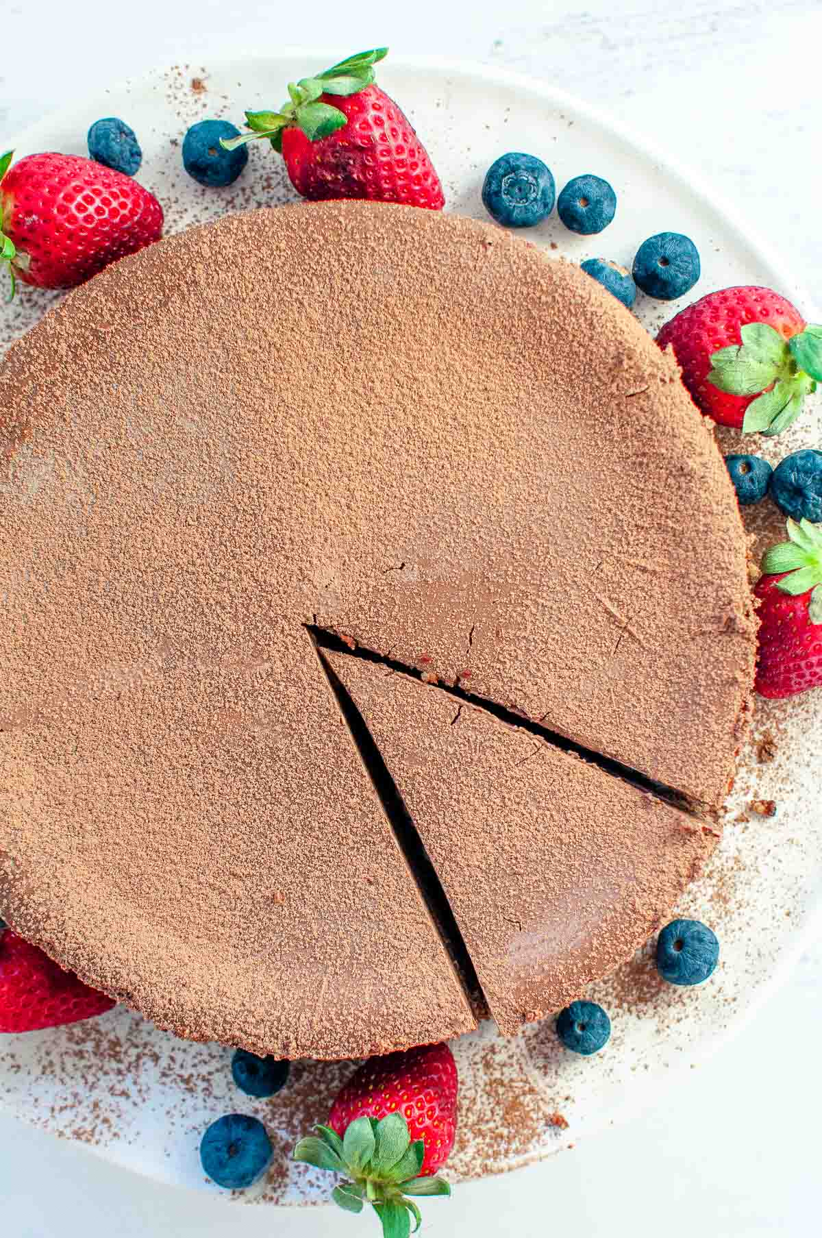 chocolate cheesecake and berries on a serving platter
