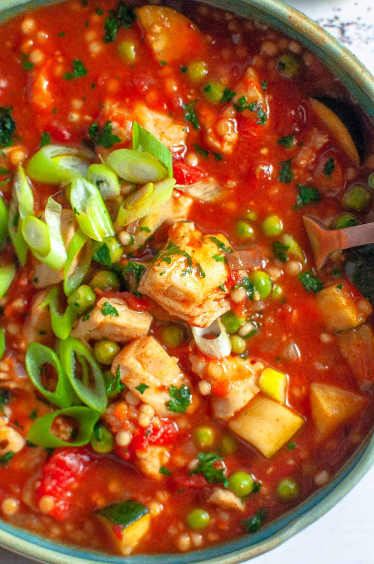 spanish fish stew in a bowl up close