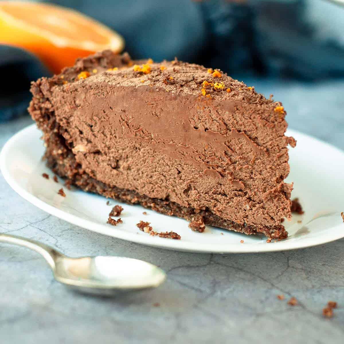 a single slice of chocolate orange cheesecake on a plate
