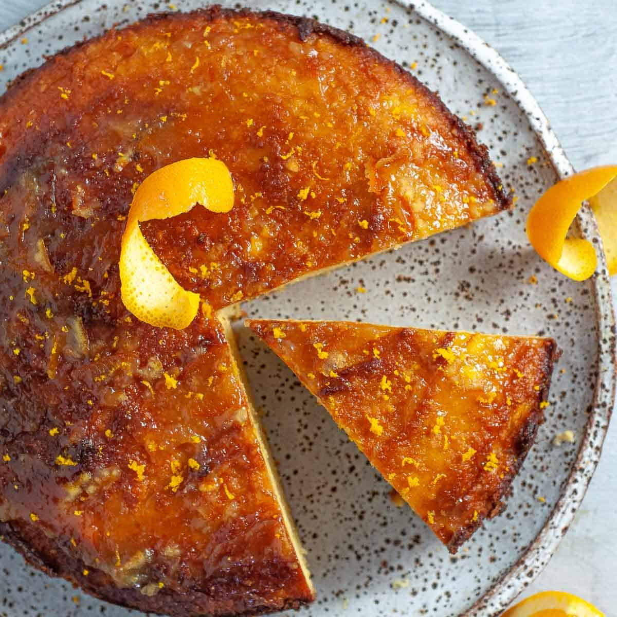healthy orange cake with slice out on a plate