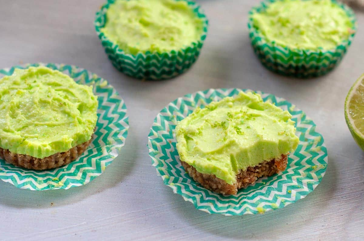 four mini lime cheesecakes on a bench