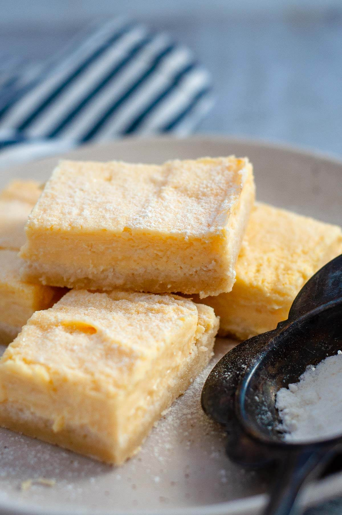 a stack of lemon bars on a serving plate
