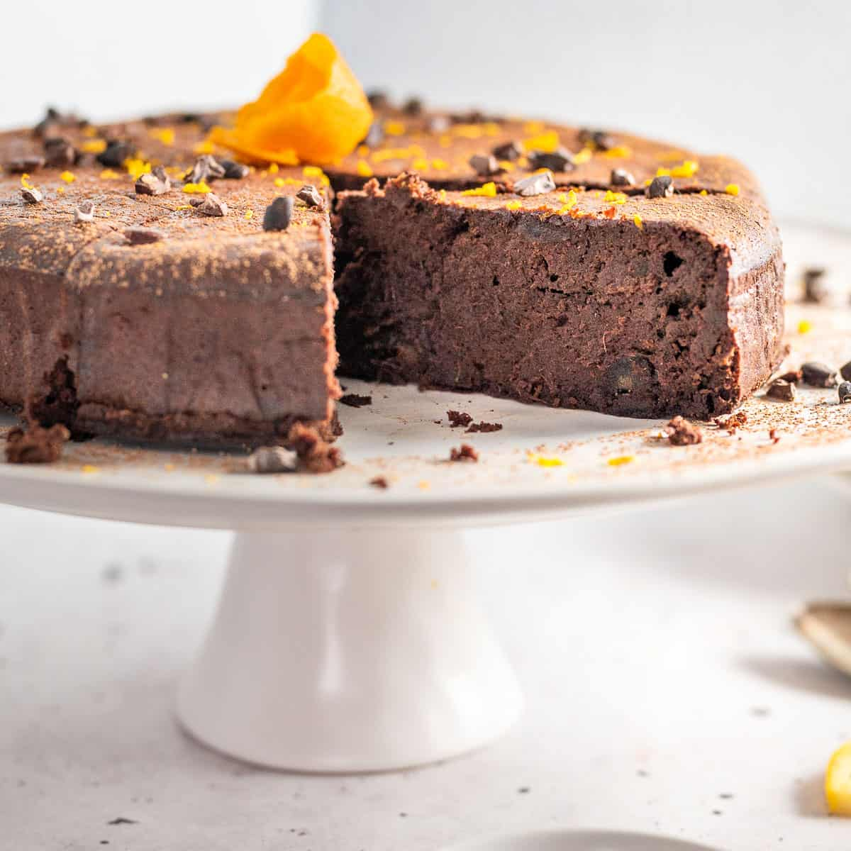 chocolate orange cake on cake stand