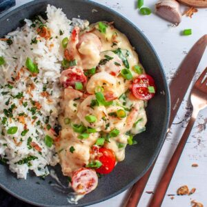creamy garlic prawns and rice in a bowl
