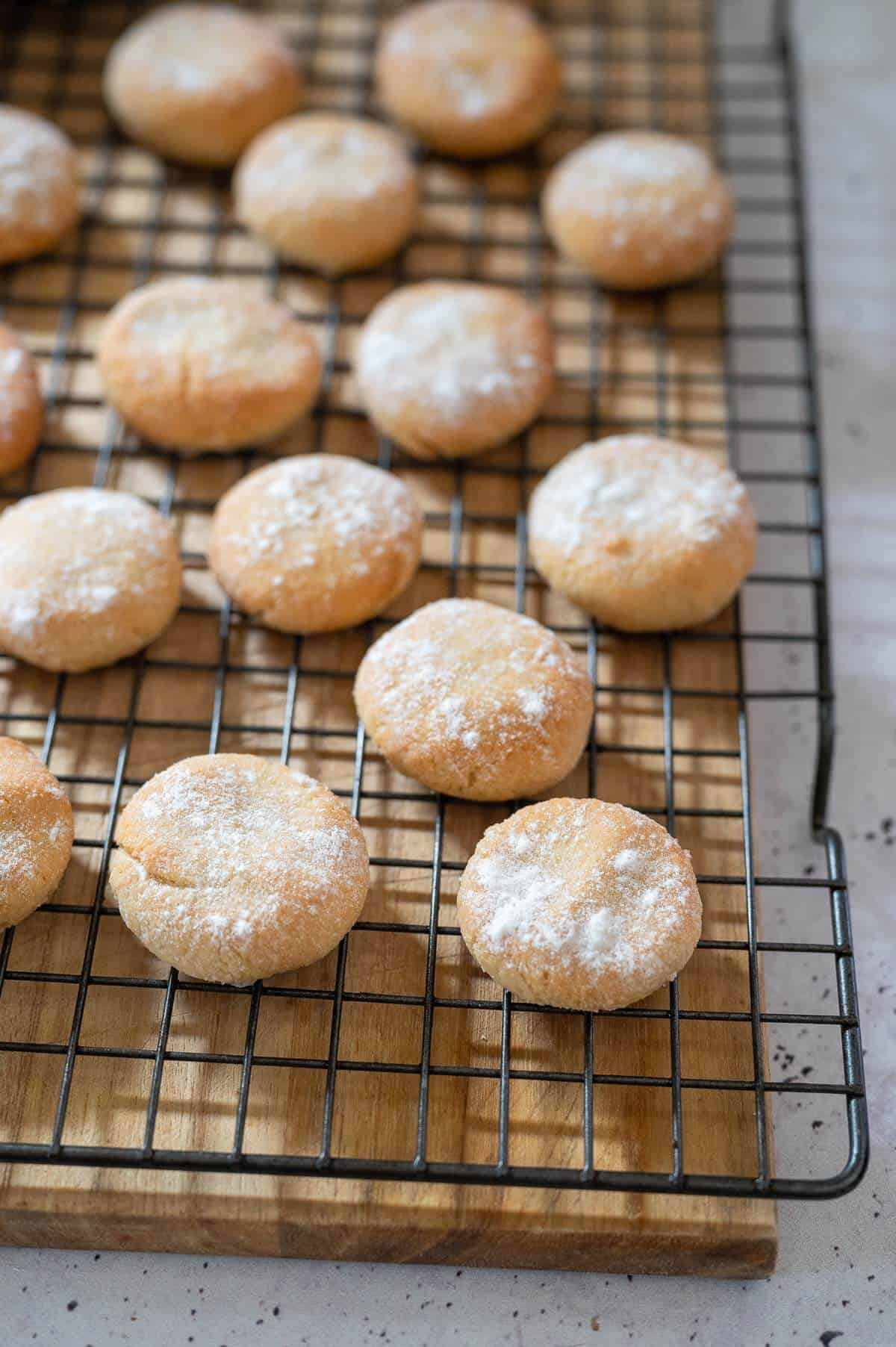 cooked amaretti biscuits scattered on a wire rack