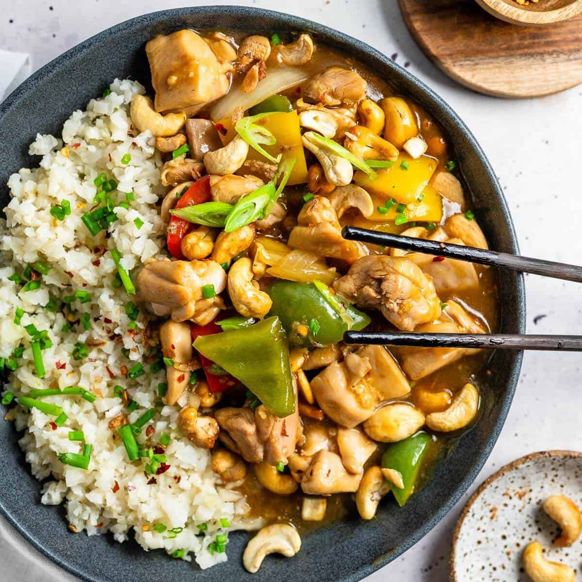 a bowl of cashew nut chicken with rice