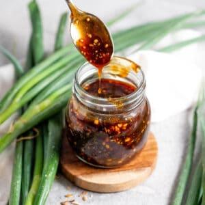 Sugar Free Teriyaki Sauce in a jar with spoon