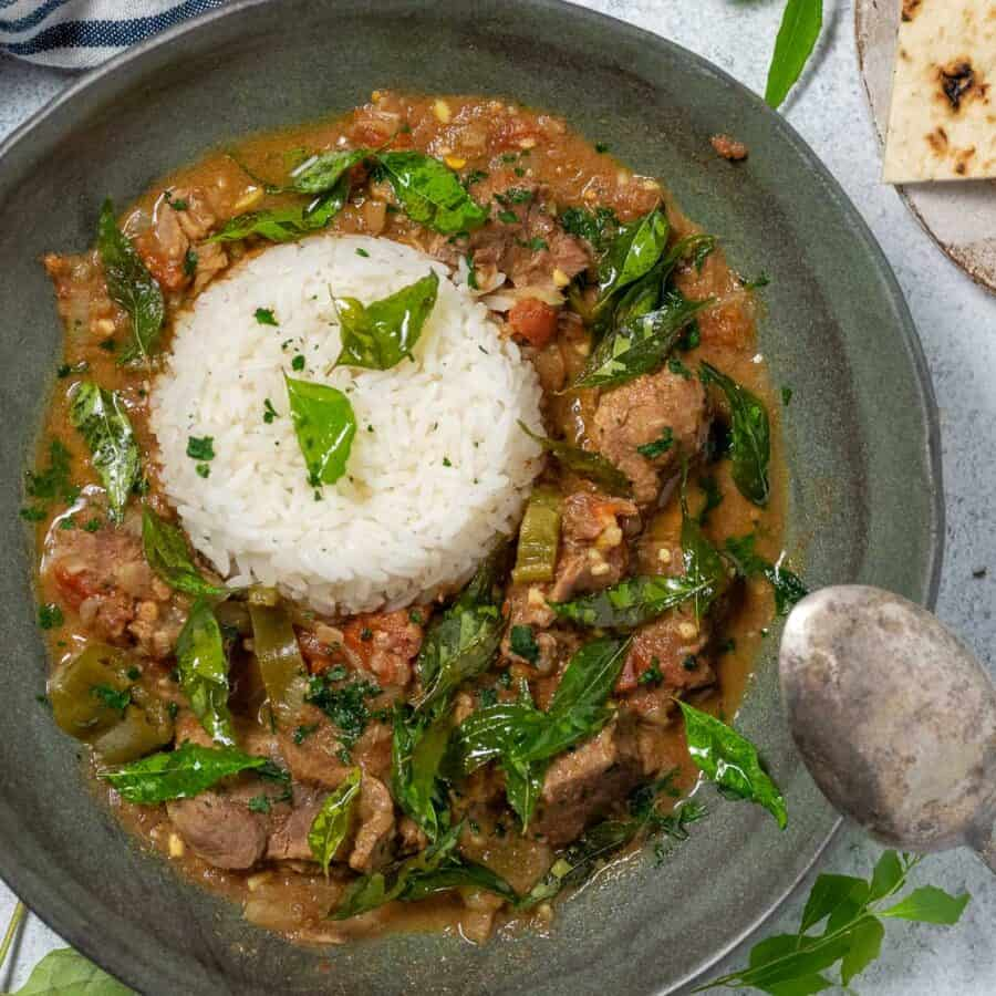 kerala beef curry with rice in a dark grey bowl