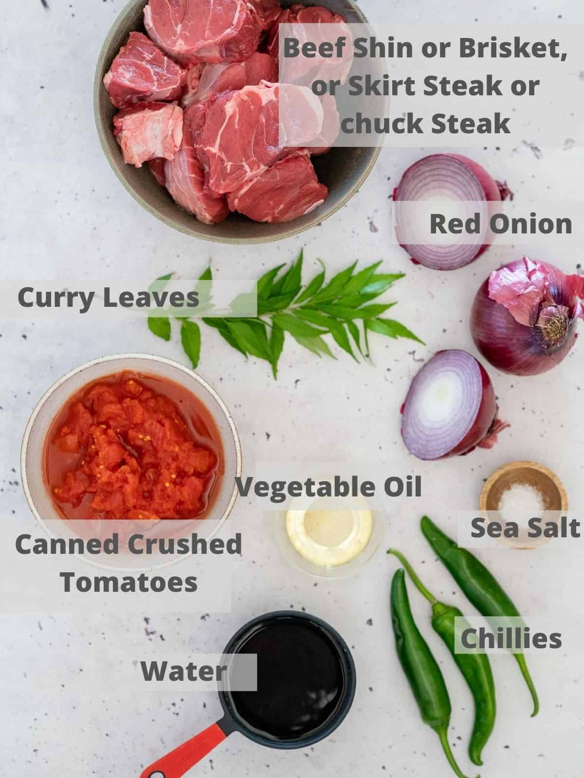 kerala beef curry ingredients on a bench