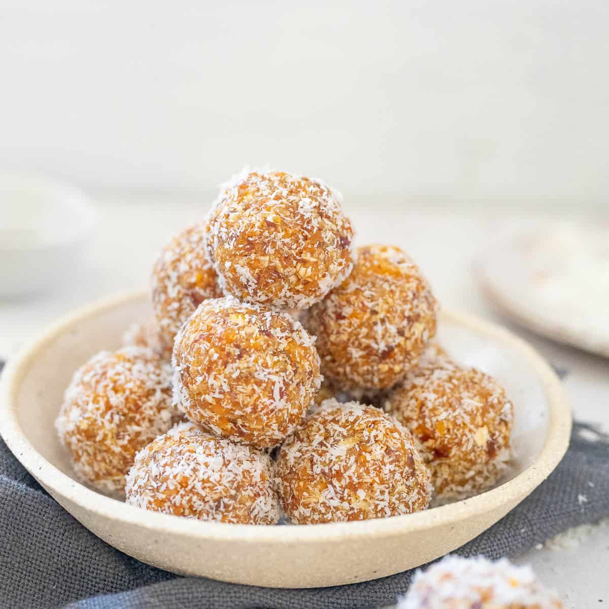 a bowl of stacked apricot bliss balls