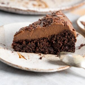 a slice of chocolate black bean cake on a plate