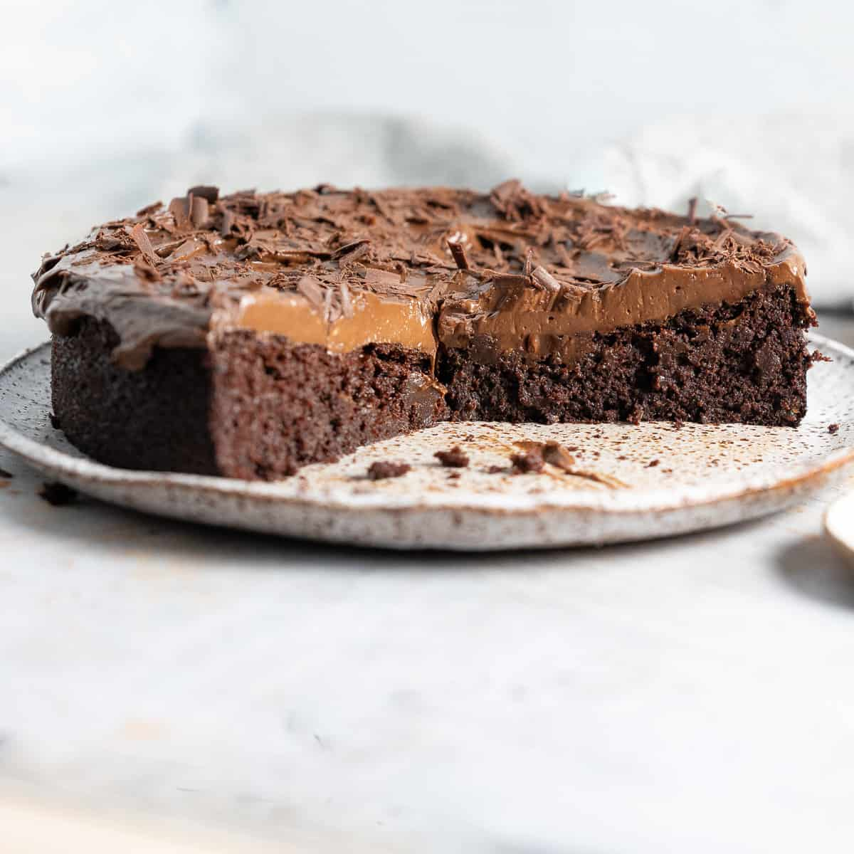 half a Black bean chocolate cake on a plate