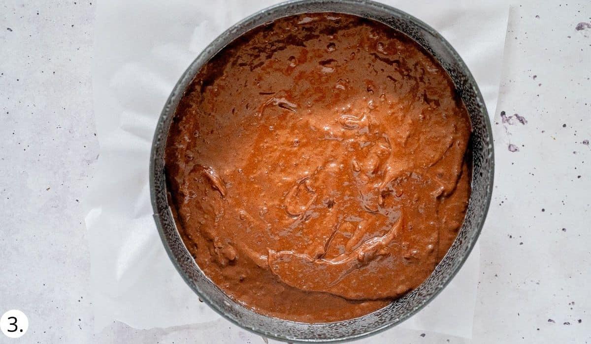 chocolate black bean cake batter  in cake tin before cooking