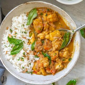 white bowl with kerala chicken and rice