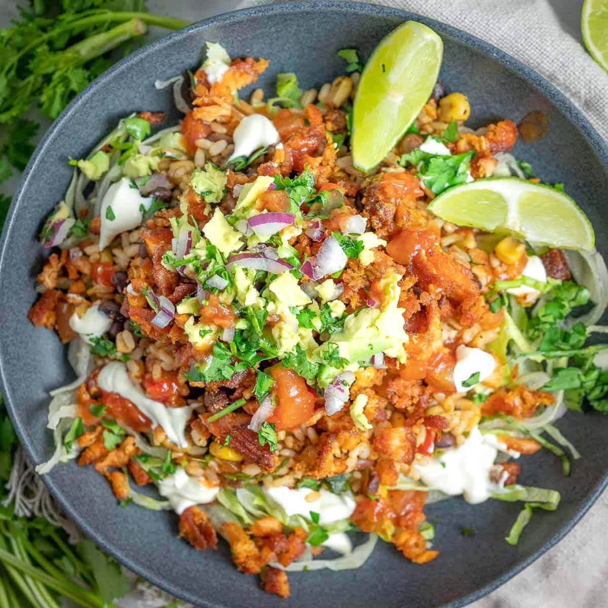 salmon burrito bowl with avocado and sour crem