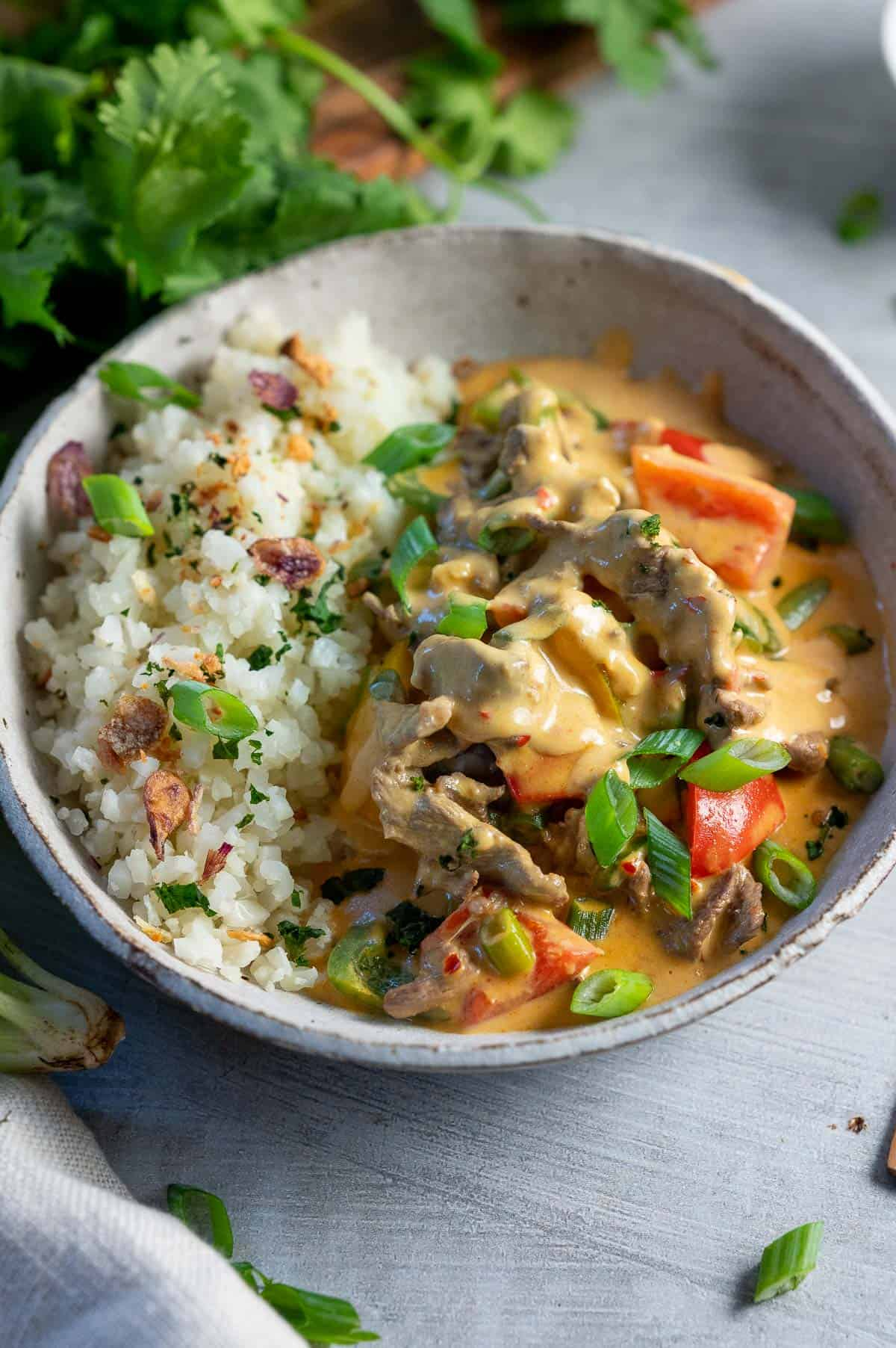 satay beef curry bowl with vegetables