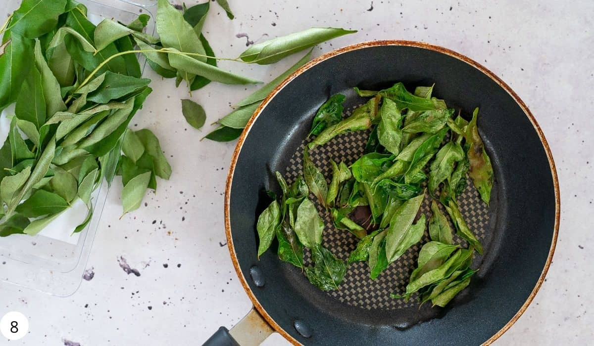 cooking curry leaves n a pan