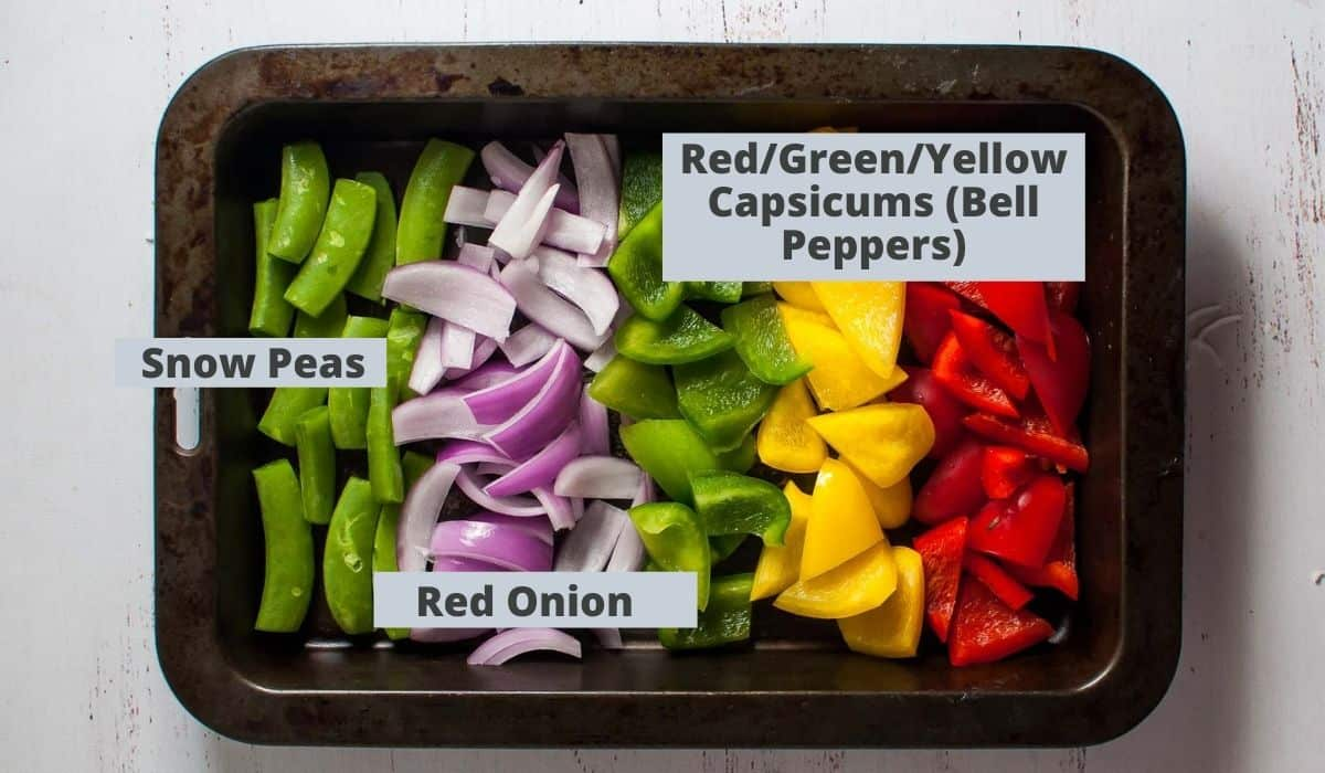 chopped vegetables in a rectangle metal tray