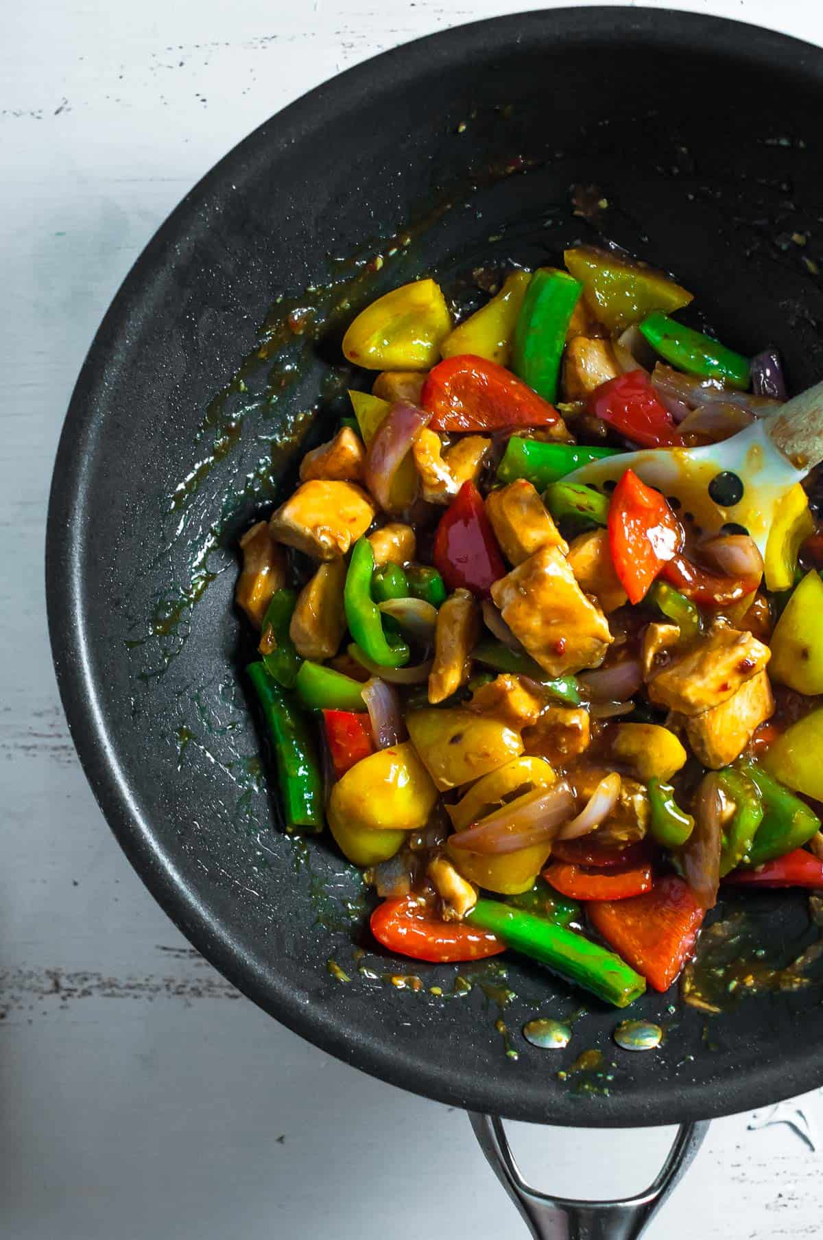 Salmon stir fry cooking in a wok