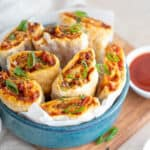 air fryer pizza rolls in a blue bowl