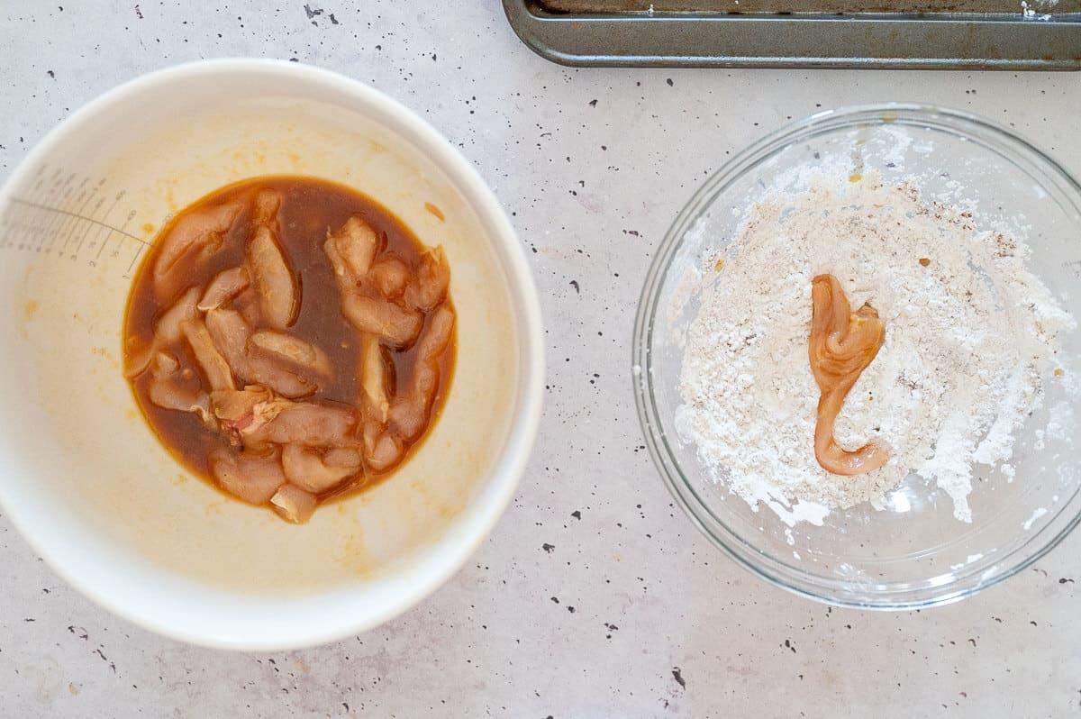 dipping chicken into flour