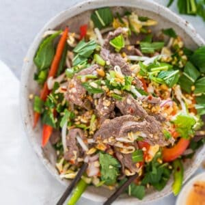 Vietnamese Beef Salad in a bowl with chopsticks