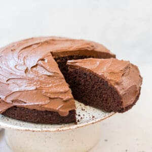 chocolate orange cake on a cake platter with slice out