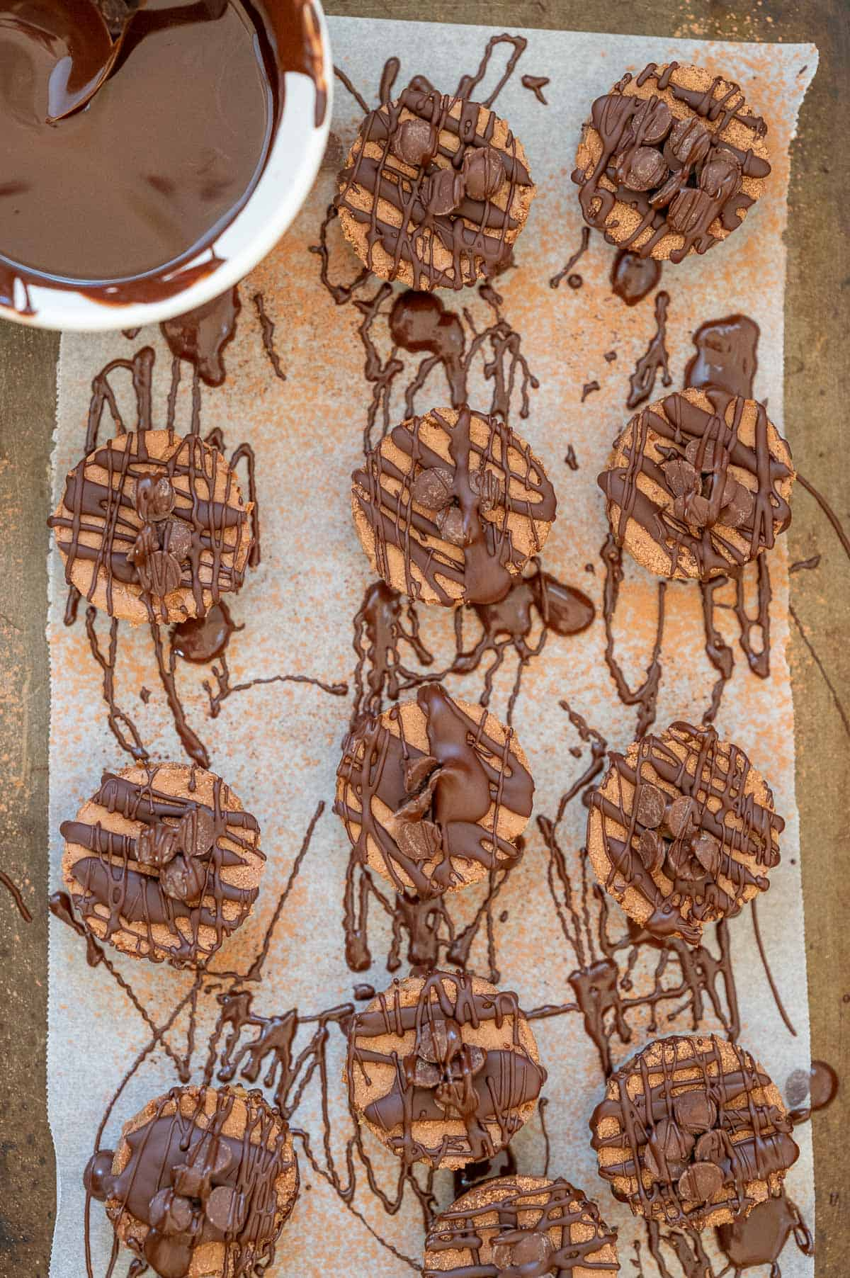 cheesecakes on a tray with chocolate drizzle