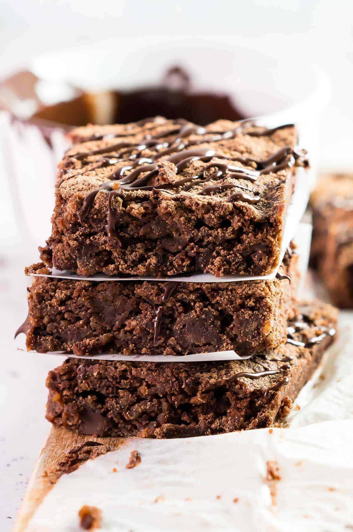 3 brownies stacked with paper separators