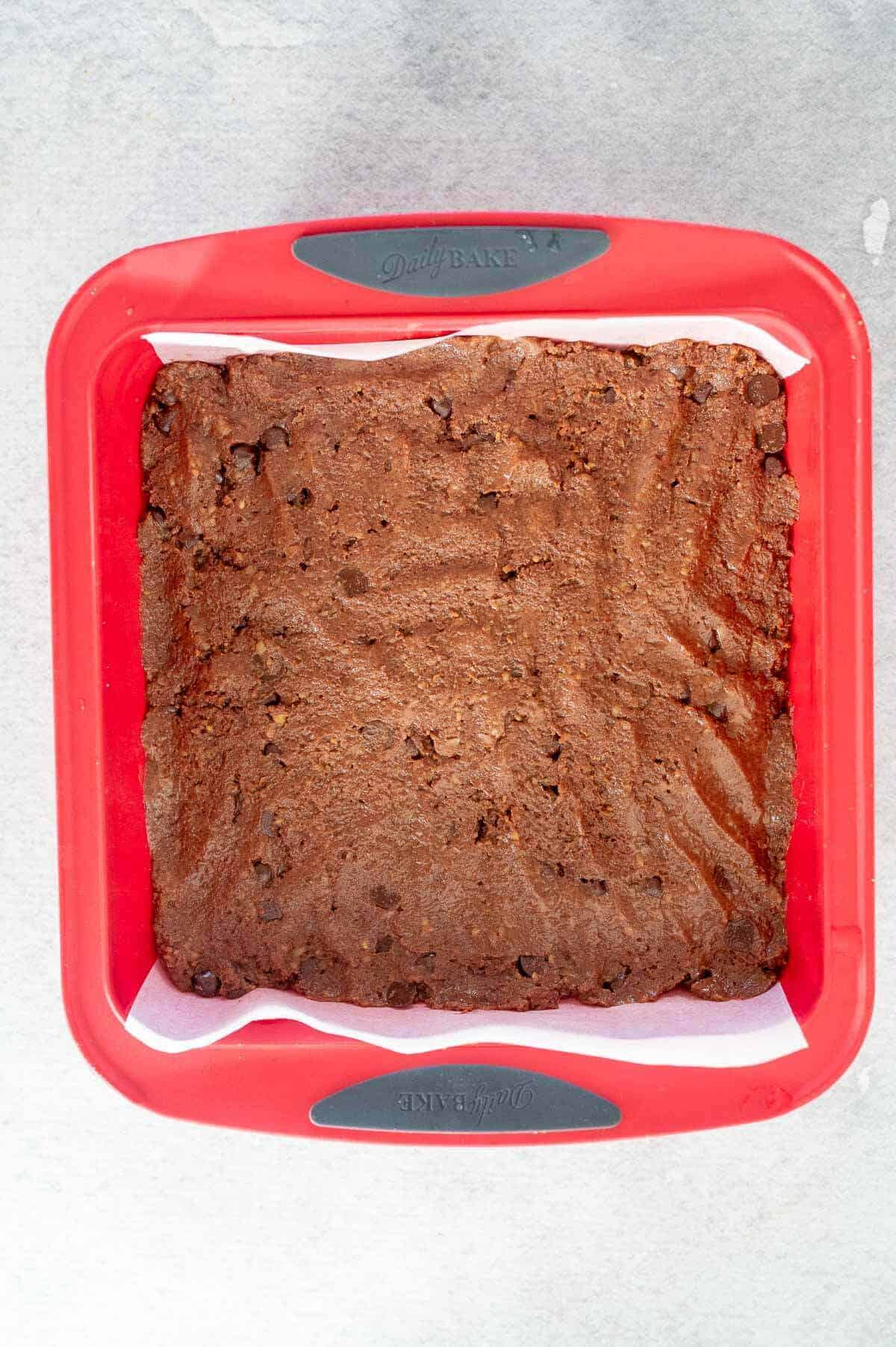 brownie batter in tin ready for baking