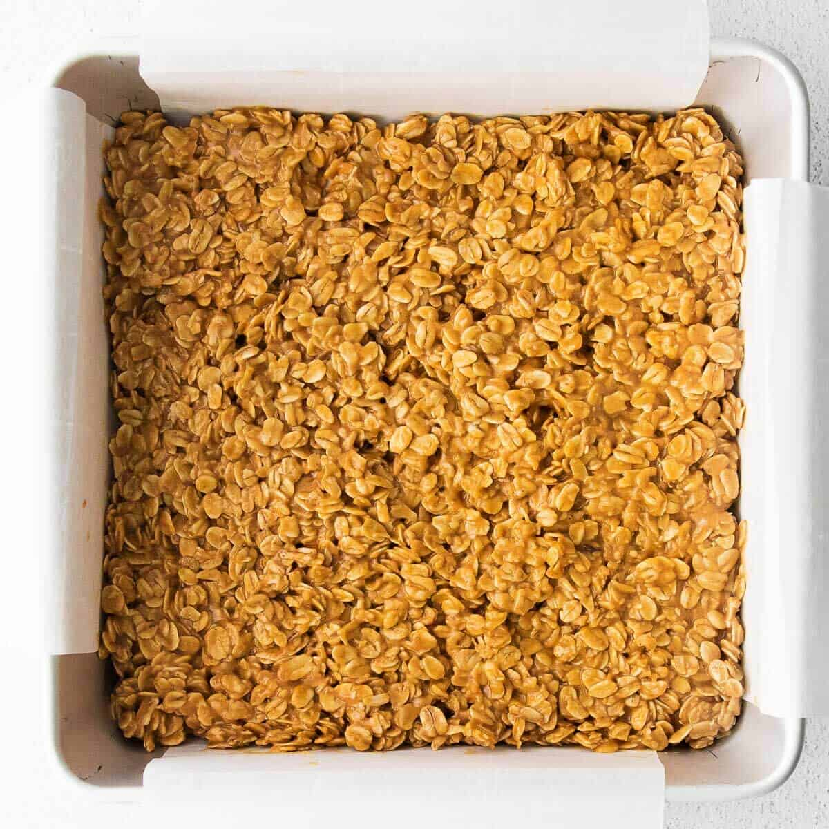 granola bar mixture spread out in a pan