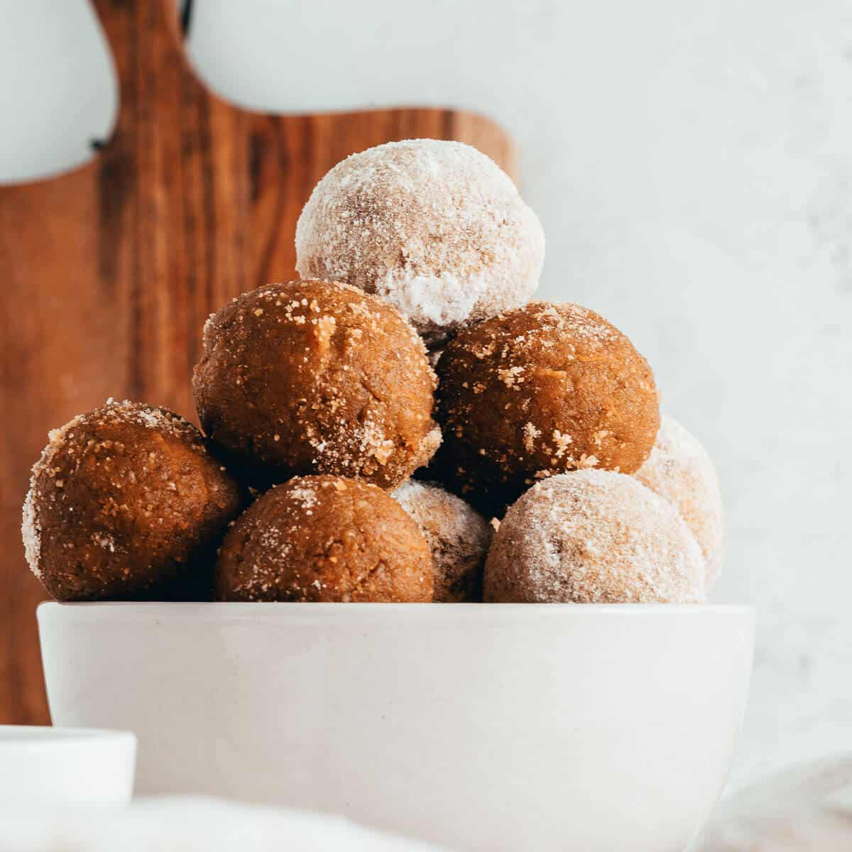 carrot cake balls stacked in a bowl